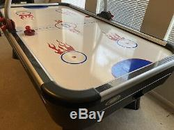 Full size air hockey table with electronic scoring and sound effects